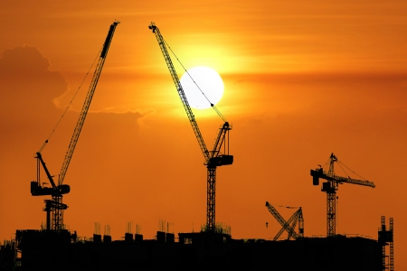 Silhouette of construction site with crane