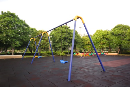 chain swings in kids playground photo