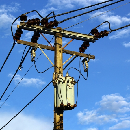 Transformer and power lines on electric pole photo