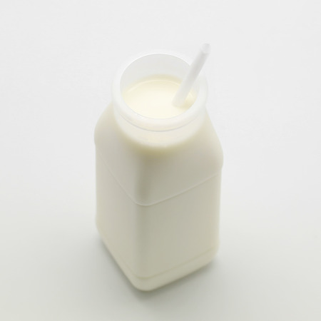 bottle of milk with white drinking straw Reklamní fotografie