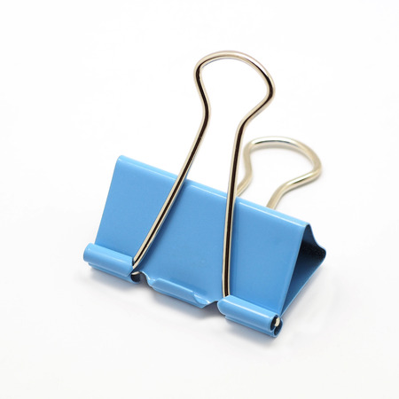 blue binder clip isolated on white background Stock Photo