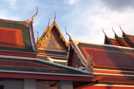 apex: gable apex on temple roof with blue sky background