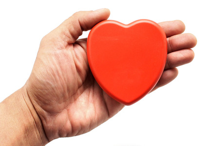 red heart in man hand Stock Photo