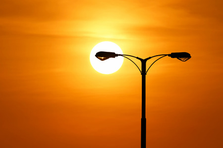 silhouette of streetlight with beautiful sunset background