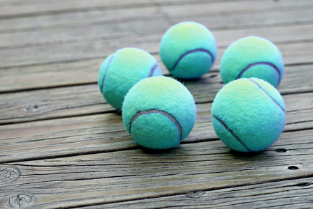 individual sport: exotic blue tennis ball  on wooden background Stock Photo