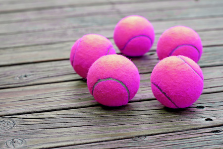 individual sport: exotic purple tennis ball  on wooden background