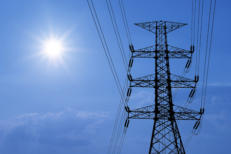 electrical tower: silhouette of high voltage electric tower with beautiful sunlight  background