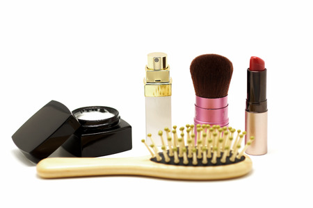 parfume: cosmetic set with parfume blusher brush lipstic and comb isolated on white background Stock Photo