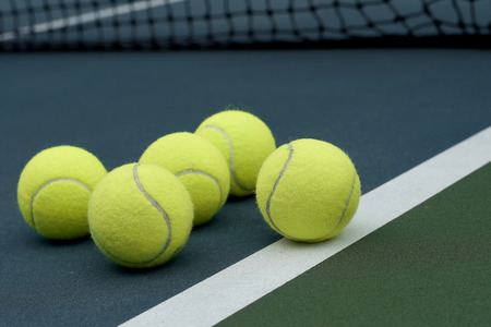 individual sport: exotic yellow color tennis ball  on court  background Stock Photo