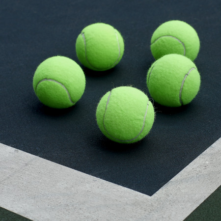 individual sport: pile of tennis ball  on court  background Stock Photo