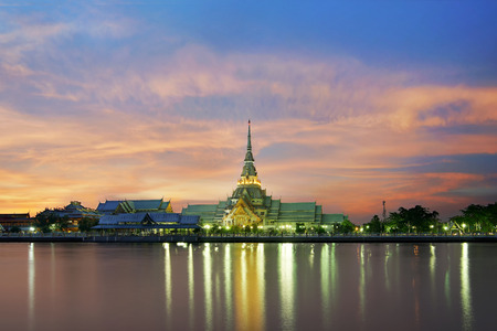 beautiful thai temple along the river at twilight time