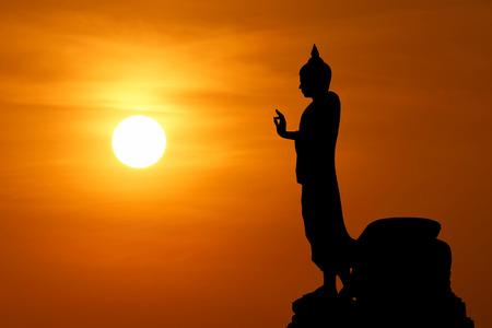 buddha image: silhouette of  buddha image with beautiful sunset background