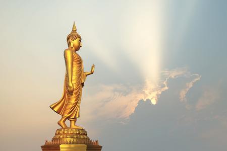 buddha image: golden buddha image with beautiful sunbeam background