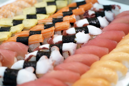 susi: sushi rolls traditional japanese food on buffet line Stock Photo