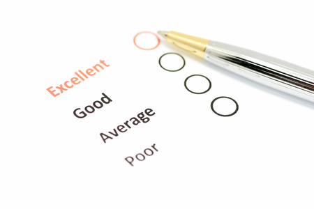 customer satisfaction survey form with the pen pointed to excellent checkbox Reklamní fotografie