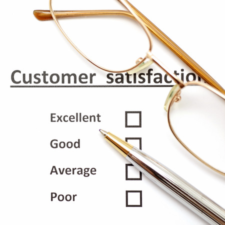 questionnaires: customer satisfaction survey form with the pen and eye glasses