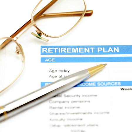 retirement: retirement plan document with pen and eye glasses Stock Photo