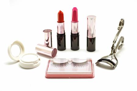 curler: makeup set with lipstick false lashes eyelash curler and  eyeshadow isolated on white background