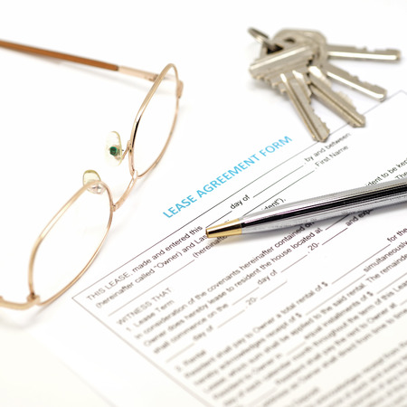 lease: lease agreement document with key and pen