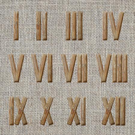 numeros romanos: roman numerals set on burlap or linen fabric background Foto de archivo