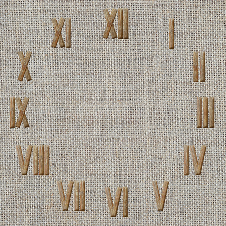 numeros romanos: n�meros romanos del reloj en la arpillera o tela de lino de fondo