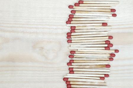 matchstick: matchstick line on wooden background Stock Photo