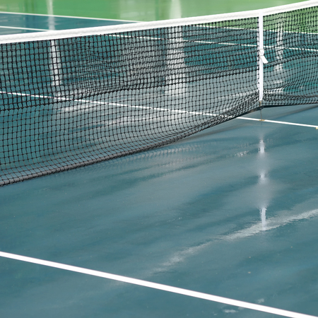 cleaning crew: wet tennis court after the rain