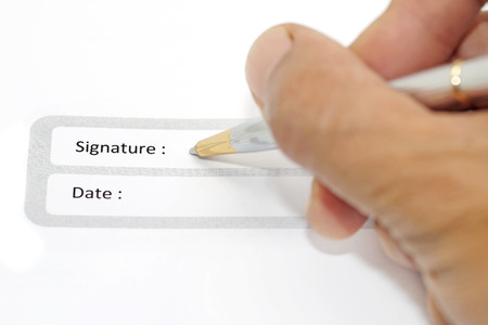 acknowledgment: signature field on document with pen and human hand Stock Photo