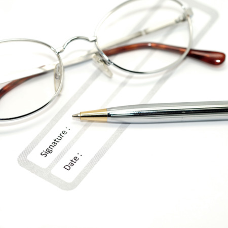 acknowledgment: signature field on document with pen and glasses
