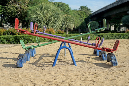 totter: old seesaw or teeter-totter in kids playground