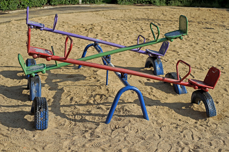 teeter: old seesaw or teeter-totter in kids playground