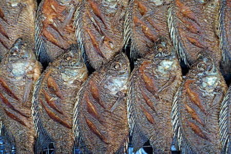 oreochromis: fried nile tilapia or oreochromis nilotica fish at street market