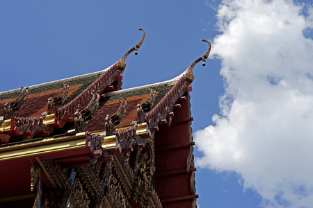 apex: gable apex on temple roof with beautiful sky background Stock Photo