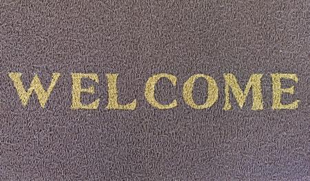 doormat: welcome text on brown doormat