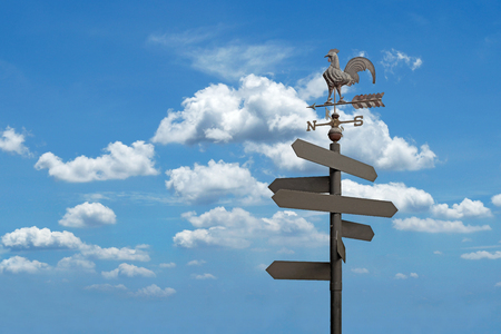 direction sign: direction sign with blank spaces for text on beautiful sky background Stock Photo
