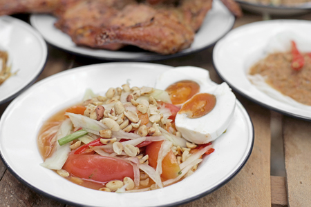 tam: famous Thai food, papaya salad or som-tam with sticky rice and vegetable