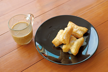 sweetened: deep fried doughstick with sweetened condensed milk on top and coffee