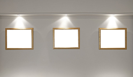 gallery interior: gallery interior, empty picture frames on the wall with lighting Stock Photo