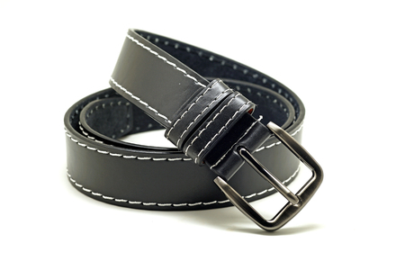 buckle: leather mens belt with silver buckle isolated on white background Stock Photo