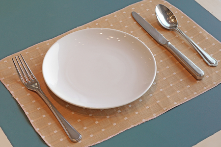 spoon and fork: spoon fork  knife and empty white plate
