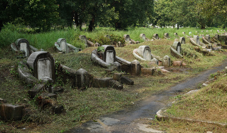 tombstones: old tombstones and graveyards in abandoned chinese cemetery Stock Photo