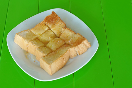 sweetened: slice toast with butter sweetened condensed milk and sugar on top