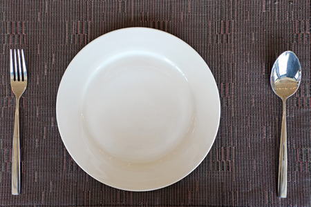 manteles: spoon fork and empty white plate on tablecloth