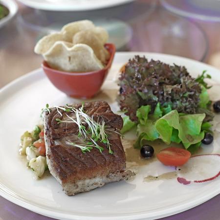 sturgeon: grilled sturgeon fish steak with cornflakes and vegetables Stock Photo