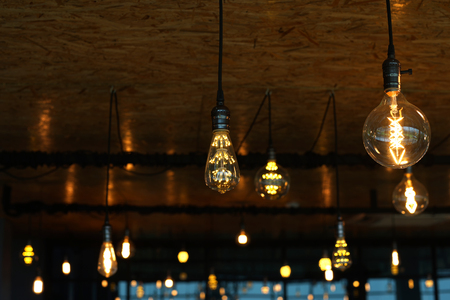 tungsten: decorative antique tungsten light bulbs hanging on ceiling Stock Photo