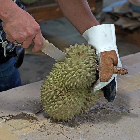 vitamin store: vendor peeling durian for customer in fruit market