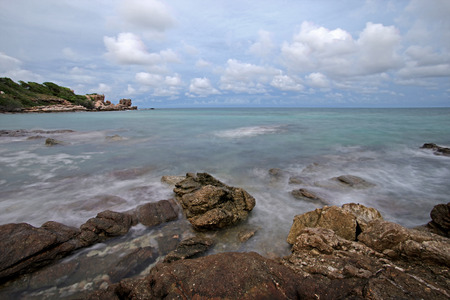 waves crashing: beautiful coastline with ocean waves crashing rocks Stock Photo