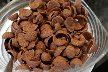 chocolate cereal: chocolate cereal corn flakes in a glass bowl