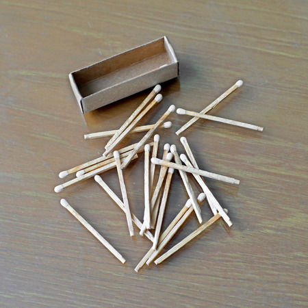 matchstick: white matchstick and matchbox on wooden table