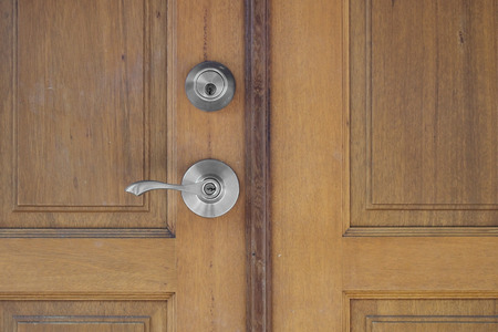 door handle: door handle and keyhole on wooden door